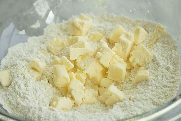 Butter cubes added to flour mixture