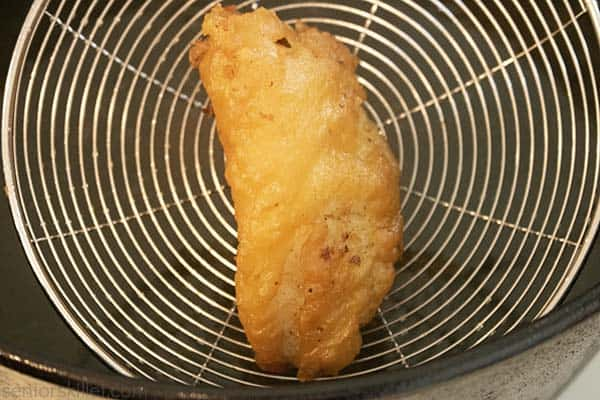 Cooked fish in strainer