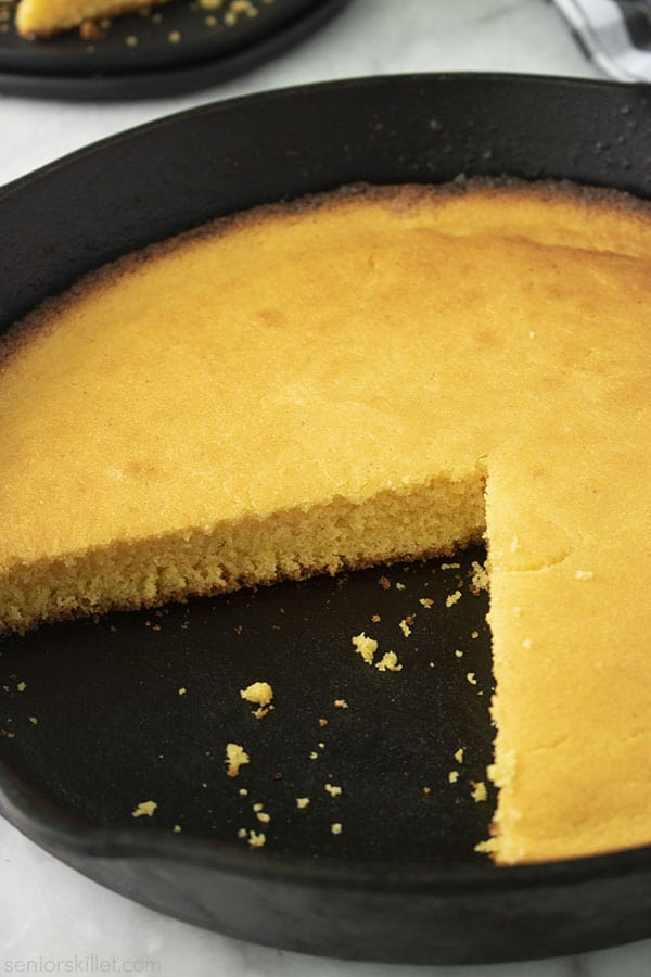 Cut southern cornbread in a cast iron skillet