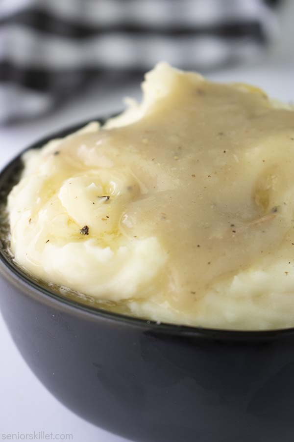 Bowl of mashed potatoes with easy gravy