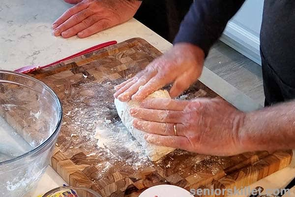 Kneading pizza crust