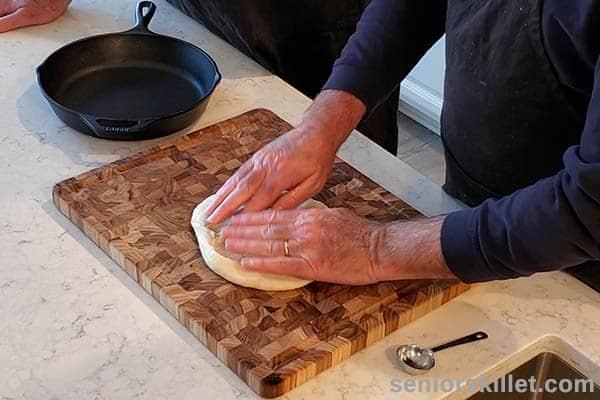 Pressing pizza dough