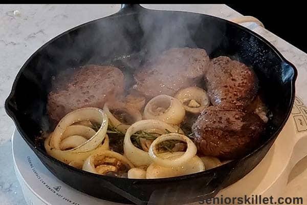 Steaks cooking