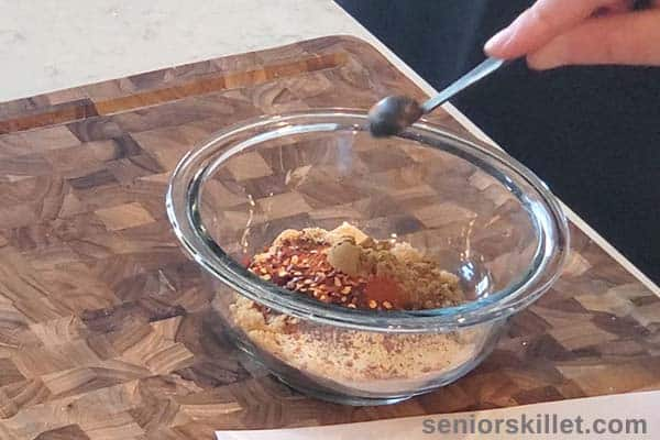 Adding spices to bowl