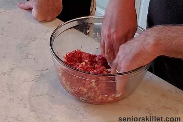 Mixing the meatloaf mixture