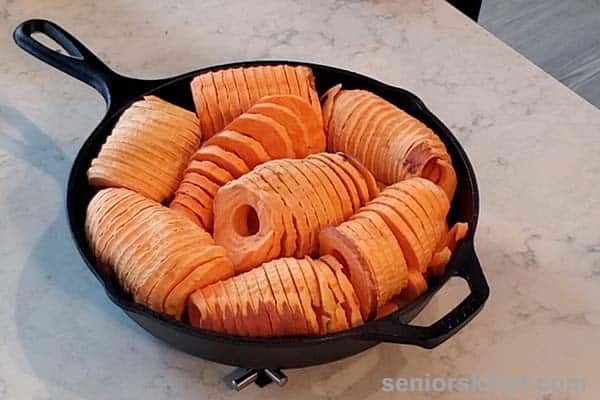 Sweet potatoes added to skillet