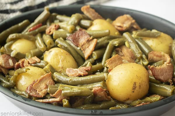 Cooked green bean and potatoes with bacon