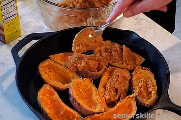 Filling sweet potato boats