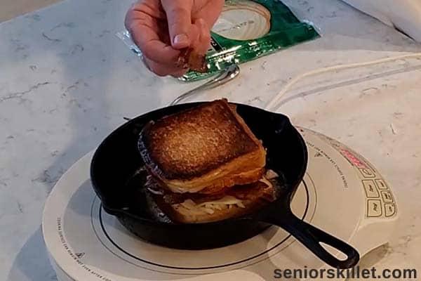 Flipped turkey sandwich in pan