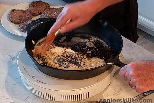 Whisking flour with steak pan drippings